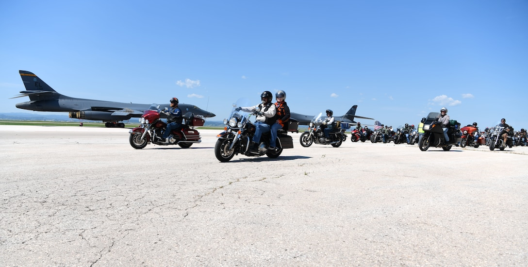 Motorcycles depart the flight line at Ellsworth Air Force Base, S.D., Aug. 6, 2019. Motorcyclists participating in the 19th annual Dakota Thunder Run rode from the base and through Vanocker Canyon to Sturgis to enjoy the rally and the 19th annual Veteran's Appreciation Ceremony. (U.S. Air Force photo by Senior Airman Thomas Karol)