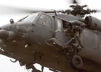 The crew of a U.S. Air Force HH-60G Pave Hawk assigned to the 55th Rescue Squadron prepare to evacuate an isolated person during exercise Red Flag-Rescue 19-1 near Davis-Monthan Air Force Base, Arizona, May 9, 2019.   Red Flag-Rescue gives joint service personnel an opportunity to build fundamental combat search and rescue skills to fight in and out of contested environments.  (U.S. Air Force photo by Airman 1st Class Duncan C. Bevan)