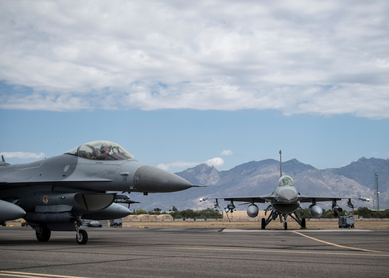 Two U.S. Air Force F-16 Fighting Falcons assigned to the 24th Tactical Air Support Squadron prepare for take off during exercise Red Flag-Rescue 19-1 at Davis-Monthan Air Force Base, Arizona, May 8, 2019.  Red Flag-Rescue gives joint service members a high-end training experience that uses multi-functional personnel to improve pilot and crew readiness capabilities. (U.S. Air Force photo by Airman 1st Class Duncan C. Bevan)