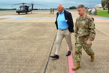 Maj. Gen. David J. Francis, Fort Rucker and USAACE commanding general, walks with retired Gen. Richard A. Cody, who visited Fort Rucker July 23-24 as chairman of the National Commission on Military Aviation Safety, at Cairns Army Airfield before an aerial tour of stagefields. (Photo Credit: Kelly Morris)