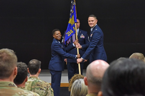 Two airmen change command during a ceremony