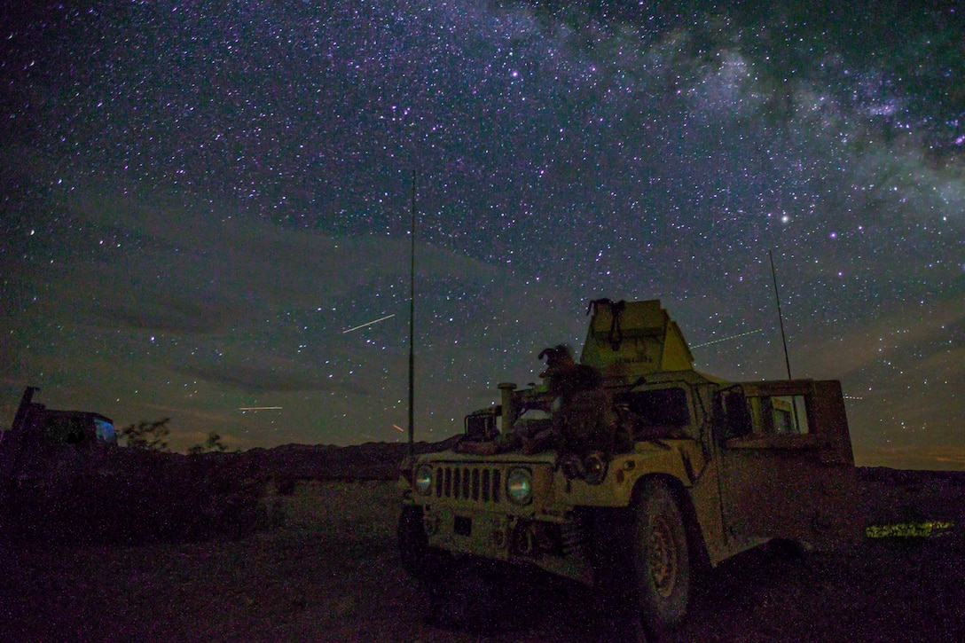 A u.s. Marine with Combat Logistics Battalion 2, Combat Logistics Regiment 2, 2nd Marine Logistics Group sits on the hood of a Humvee before advanced motorized operations course as part of integrated training exercise 5-19 on Marine Air Ground Combat Center Twentynine Palms, Aug. 02, 2019. The purpose of ITX 5-19 is to create a challenging, realistic training environment that produces combat-ready forces capable of operating as an integrated Marine Air Ground Task Force.
