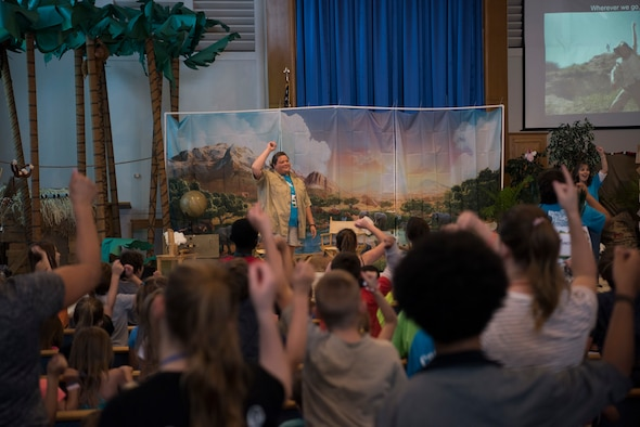 Kelly Gray, 366th Fighter Wing catholic religious coordinator, leads children in a song and dance during Vacation Bible School (VBS) August 6, 2019, at Mountain Home Air Force Base, Idaho. VBS is an annual event put on for youth to grow their faith and strengthen community relationships. (U.S. Air Force photo by Airman 1st Class Andrew Kobialka)
