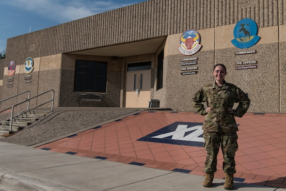 "Staff Sgt. Samantha Schienost, 47th Operations Support Squadron Host Aviation Resource Management NCO in charge,  was awarded the ""XLer"" of the week, July 31, 2019 at Laughlin Air Force Base, Texas, for her ingenuity with innovating processes and taking the time to improve herself through going to college—all while keeping her shop afloat. ""It's great even to be considered and to know my command shows the confidence they have in in me to maintain HARM's day-to-day operations,"" Scheinost said. (U.S. Air Force photo by Senior Airman Anne McCready)"