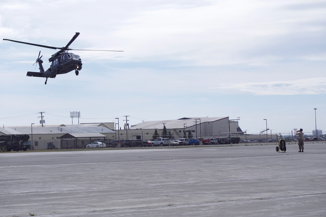 Piloted by Alaska Air National Guard Maj. Paul Rauenhorst and Capt. Seth Peterson, the first 210th Rescue Squadron Operational Loss Replacement HH-60G Pave Hawk is delivered Aug. 5, 2019, to Joint Base Elmendorf-Richardson, Alaska.