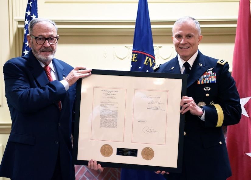 JOINT BASE ANACOSTIA-BOLLING, D.C. (July 31, 2019) Retired Lt. Gen. Patrick Hughes, serving as the Office of Strategic Service Society Representative, presenting the OSS Congressional Gold Medal to DIA Director Lt. Gen. Robert P. Ashley Jr. (DIA photo by David Richards/Released)