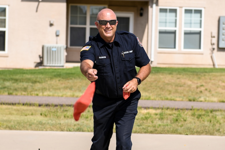 Dan Gordon, Buckley Fire Department station chief, plays cornhole at the National Night Out event, Aug. 6, 2019, on Buckley Air Force Base, Colo. The event brought the Fire Department, Security Forces and the community together.(U.S. Air Force photo by Airman Andrew I. Garavito)