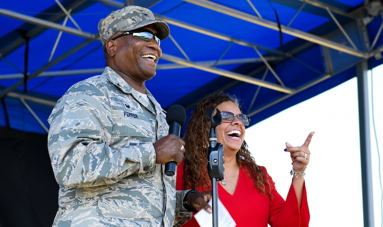 Col. Devin Pepper, 460th Space Wing commander, and his wife, Alicia Pepper, greet members of Team Buckley at Buckley's National Night Out event, Aug. 6, 2019, at Buckley Air Force Base, Colo. Buckley's first responders took a break from fighting crime and came out to the event to bring the community together. (U.S. Air Force photo by Airman Andrew I. Garavito)