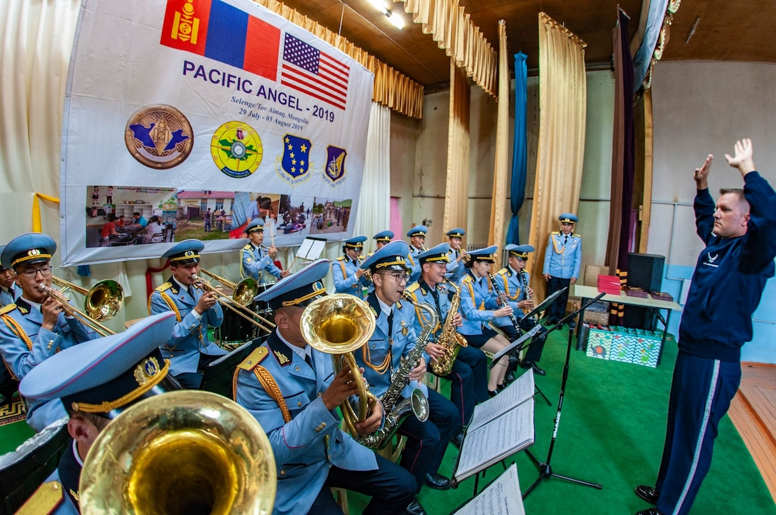 CMSgt Stephen Larson conducts the American Anthem for the closing ceremonies of this year's Pacific Angel 19-3 in Mongolia.