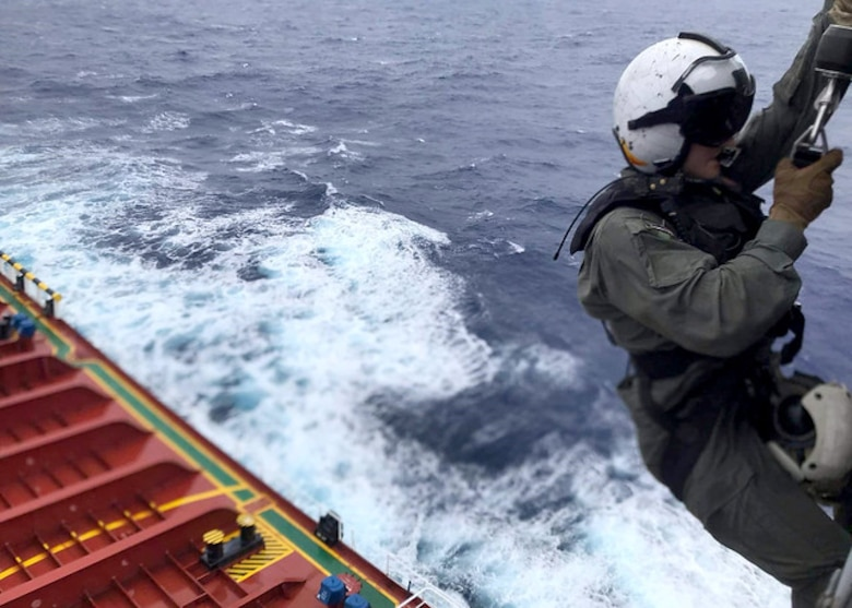 PACIFIC OCEAN (Aug. 6, 2019) Naval Air Crewman (Helicopter) 2nd Class Nathan Swartz from Elmhurst, Illinois, is lowered to the deck of Chinese-flagged vessel CSC Brave to assess a Cpatient and prepare him for movement via litter hoisting during a medical evacuation mission by the �Island Knights� of Helicopter Sea Combat Squadron (HSC) 25. The Guam-based �Island Knights� of Helicopter Sea Combat Squadron (HSC) 25 responded to the Chinese civilian in distress in the Pacific, Aug. 6.