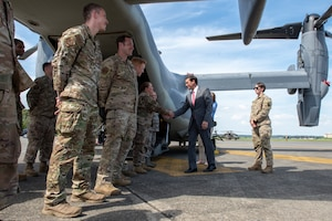 U.S. Secretary of Defense Dr. Mark T. Esper shakes hands with the Airmen of the 353rd Special Operations Group prior to departing Yokota Air Base, Japan to continue his Pacific Tour, Aug. 7, 2019.