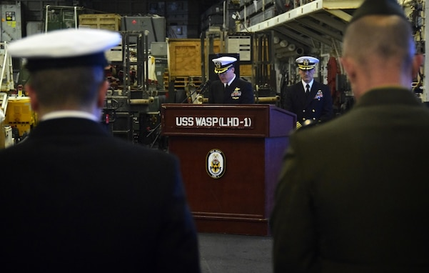 CORAL SEA (Aug. 3, 2019) – Cmdr. Steven Stougard, command chaplain, USS Wasp (LHD 1), from Vashon Island, Washington, delivers a prayer during a wreath laying ceremony held in remembrance of the aircraft carrier USS Wasp (CV-7) aboard the amphibious assault ship USS Wasp (LHD 1). Wasp, flagship of the Wasp Amphibious Ready Group, with embarked 31st Marine Expeditionary Unit, is operating in the Indo-Pacific region to enhance interoperability with partners and serve as a ready response force for any type of contingency.