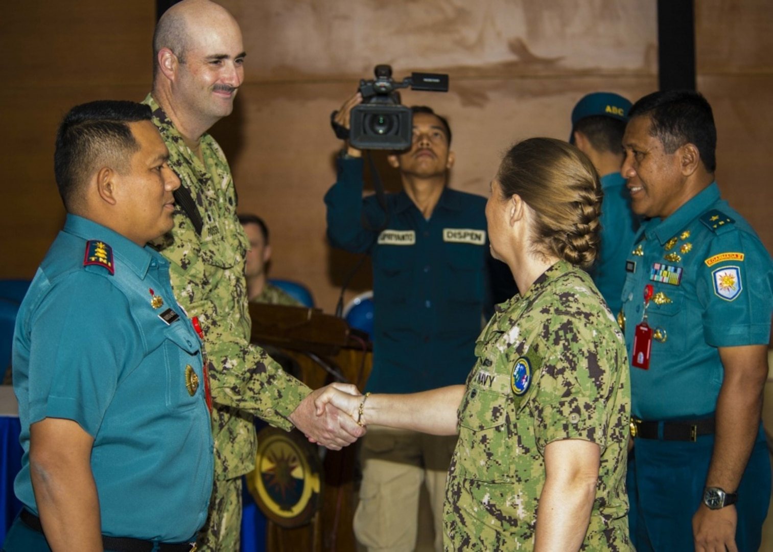 JAVA SEA (August 7, 2019) Senior U.S. and Indonesian Navy delegations formerly greet each other during the closing ceremony of Cooperation Afloat Readiness and Training (CARAT) Indonesia 2019. CARAT, the U.S. Navy's longest running regional exercise in South and Southeast Asia, strengthens partnerships between regional navies and enhances maritime security cooperation throughout the Indo-Pacific.
