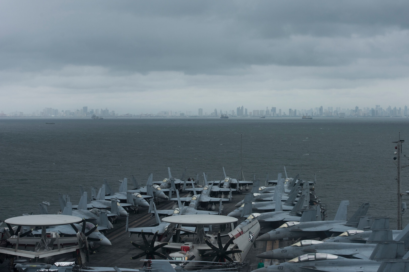 190807-N-KP021-0004 MANILA, Philippines (August 9, 2019) The aircraft carrier USS Ronald Reagan (CVN 76) anchors outside Manila, Philippines. Ronald Reagan is forward-deployed to the U.S. 7th Fleet area of operations in support of security and stability in the Indo-Pacific region.