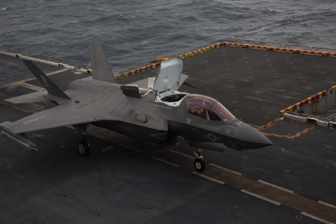 An F-35B Lightning II fighter aircraft with Marine Medium Tiltrotor Squadron 265 (Reinforced), 31st Marine Expeditionary Unit, loaded with a Joint Direct Attack Munition and a laser guided bomb, prepares to take off during an aerial gunnery and ordnance hot-reloading exercise aboard the amphibious assault ship USS Wasp (LHD 1), Solomon Sea, August 4, 2019. Wasp, flagship of the Wasp Amphibious Ready Group, with embarked 31st MEU, is operating in the Indo-Pacific region to enhance interoperability with partners and serve as ready-response force for any type of contingency, while simultaneously providing a flexible and lethal crisis response force ready to perform a wide range of military operations. (U.S. Marine Corps photo by Lance Cpl. Dylan Hess)