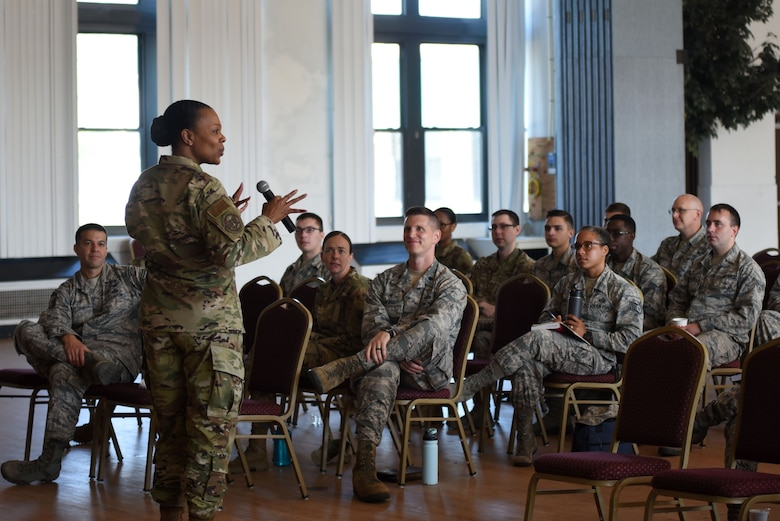 U.S. Air Force Chief Master Sgt. Janna Wesley, Chief of Military Force Management, speaks with 70th Intelligence, Surveillance and Reconnaissance Wing Airmen during a diversity and inclusion briefing at Fort George G. Meade, Maryland, Aug. 6, 2019. Wesley delivered a speech and discussed overcoming barriers, as well as helping Airmen identify unconscious biases. (U.S. Air Force photo by Airman 1st Class Madison Frazier)