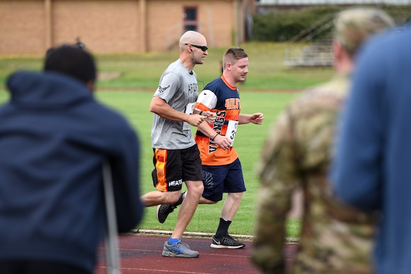 Liberty Wing Airmen run laps to help raise money for Operation Warm Heart at Royal Air Force Lakenheath, England, August 2, 2019. For each lap completed during the event, the runner's sponsors donated money to OWH which provides emergency funds for Airmen in difficult situations.(U.S. Air Force photo by Airman 1st Class Madeline Herzog)