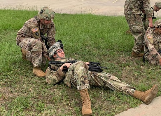 Spc. Matt Oldham, top, takes part in a training exercise with his National Guard unit, C Company, Third Battalion, 144th Infantry Regiment from Seagoville, Texas. Oldham said his Army combat buddy care and lifesaver training helped him successfully pull a driver from a wrecked vehicle on July 24 in downtown Dallas.