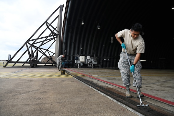U.S. Air Force Senior Airman Matthew Bonjoe Rosario, 48th Civil Engineer Squadron structural apprentice, prepares a protected aircraft shelter for maintenance at Royal Air Force Lakenheath, England, Aug. 7, 2019.  A PAS is necessary to house aircraft during inclement weather allowing maintenance personnel the ability to service the aircraft through adverse conditions. (U.S. Air Force photo by Airman 1st Class Shanice Williams-Jones)