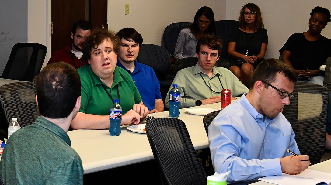 Interns discuss challenges and share ideas to overcome these in the workplace during an Autism at Work program lunch-in at Wright-Patterson Air Force Base. The Autism at Work program, a collaboration between the AFMC and Wright State University, offers students and recent graduates with a diagnosis on the autism spectrum the opportunity to participate in paid, one-year internships as Air Force civilians.  (U.S. Air Force photo / Darrius A. Parker)