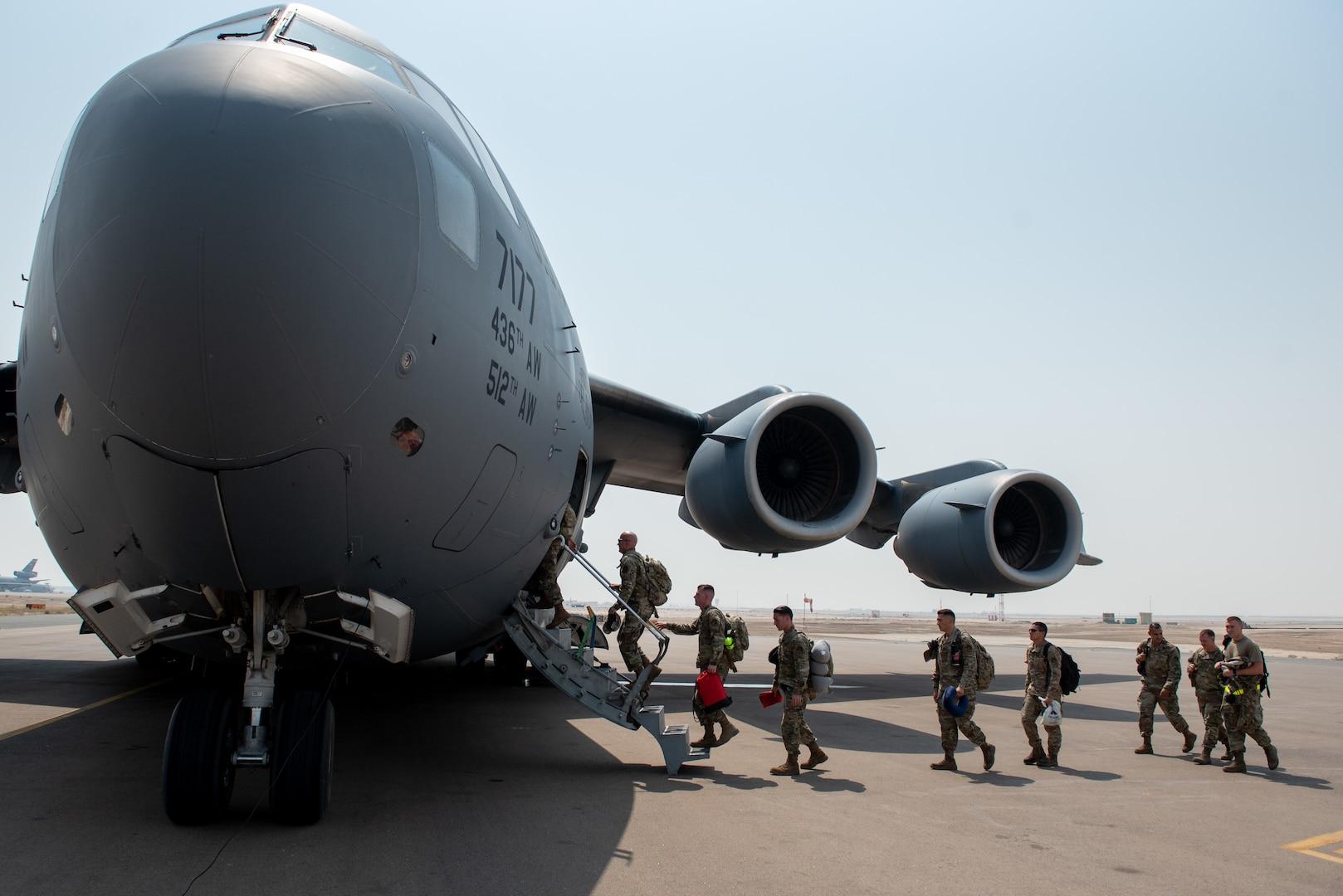 A photo of Airmen boarding a C-17