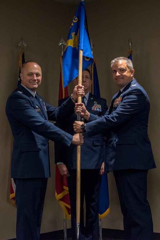 Col. Robert I. Kinney, 188th Wing commander, passes the 188th Operations Group guidon to Col. Patric D. Coggin, 188OG commander, during a change of command ceremony August 7, 2019, at Ebbing Air National Guard Base, Ft. Smith, Arkansas. Coggin assumed command of the group from Col. Jeremiah S. Gentry, who will be promoted to the position of wing vice commander during the wing's August 2019 unit training assembly. (U.S. Air National Guard photo by Tech. Sgt. John E. Hillier)