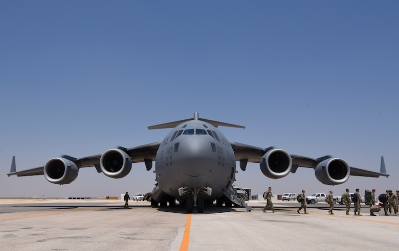 Maintainers disembarking a C-17