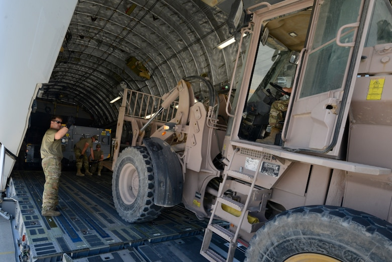 Airmen transporting gear.