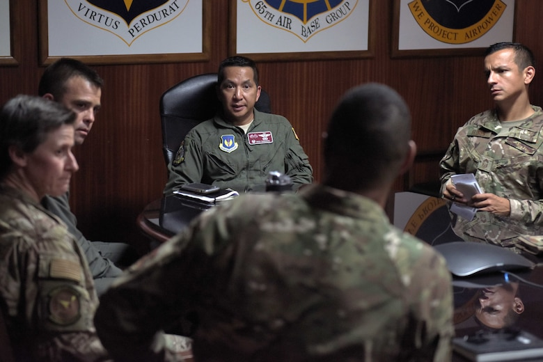 Col. Troy Pananon, 100th Air Refueling Wing commander, meets with Airmen of the 496th Air Base Squadron, at Moron Air Base, Spain, Aug. 6, 2019. Pananon met with the installation commander, inspected the dorms and recognized several top performers for outstanding achievements during his visit. (U.S. Air Force photo by Senior Airman Benjamin Cooper)