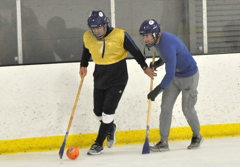 Lt. Col David Manrrique, 38th Reconnaissance Squadron commander, controls the ball as Maj. Nick Christi, 38th RS assistant director of operations, attempts to steal during a game of Broomball June 21, 2019, at Grover Ice Rink, Omaha, Nebraska. This resiliency event was made possible through funds from the Unite Program set up by the Air Force Services Activity earlier this year to promote unit cohesion. The program is the vision of Gen. David L. Goldfein, Air Force chief of staff, who recognized the need to take care of our squadrons by allowing units to focus on resiliency and cohesion for its members.