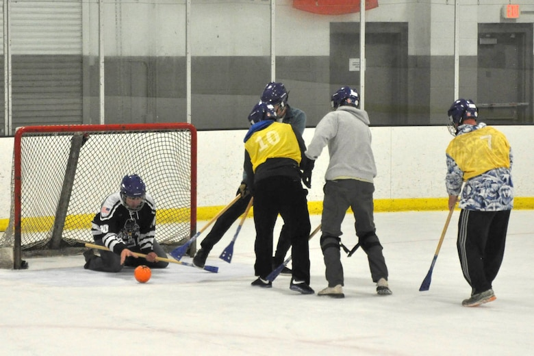 Members of the 38th Reconnaissance Squadron attempt to score while playing a game of Broomball June 21, 2019, at Grover Ice Rink, Omaha, Nebraska. Broomball is one of the many unit cohesion events made possible by the Unite Program established earlier this year. The program is the vision of Gen. David L. Goldfein, Air Force chief of staff, who recognized the need to take care of our squadrons by allowing units to focus on resiliency and cohesion for its members.