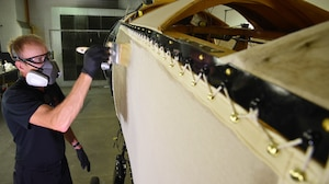 DAYTON, Ohio -- Museum restoration specialist Brian Lindamood applies 50/50 dope to the Avro 504K fuselage on Aug. 7, 2019. This aircraft was originally built in 1966 by the Royal Canadian Air Force's Aircraft Maintenance & Development Unit. Preserving the Air Force's proud legacy, the Restoration Division restores aircraft and aerospace vehicles to historically accurate and visually striking levels. (U.S. Air Force photo by Ken LaRock)