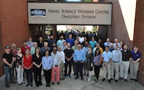 IMAGE: DAHLGREN, Va. (Aug. 8, 2019) - The CIAT – Combined Integrated Air and Missile Defense (IAMD) and Anti-Submarine Warfare (ASW) Trainer – team is pictured at Naval Surface Warfare Center (NSWC) Dahlgren Division headquarters. The team worked with NSWC Carderock Division to develop a technical approach that originated during the early stages of CIAT's combat system virtualization and technology exploration. NSWC Dahlgren Division is the lead integrator and the IAMD developer for CIAT. NSWC Carderock Division is the ASW developer and Naval Undersea Warfare Center Newport Division is the ASW components developer. The three divisions delivered CIAT to the Fleet shore based facilities in 2018 as the most capable combat systems trainer ever developed for the Navy surface force.