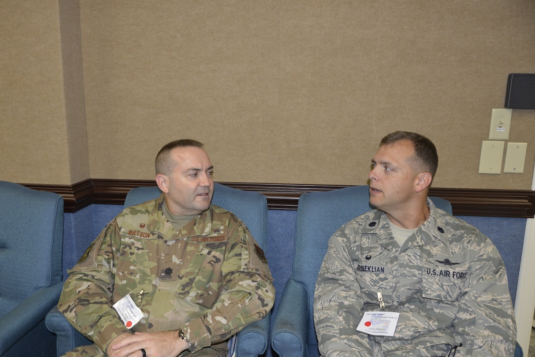 (Left) Lt. Col. Wesley Watson, Commander, 101st Air Communications Squadron, 601st Air Operations Center,  talks with Lt. Col. Lt. Col. Jeffrey Kerneklian, Commander, 224th Support Squadron, Eastern Air Defense Sector, during the 2019 Cyber Summit. (Air Force photo by Mary McHale)