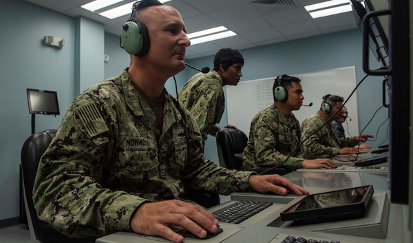 IMAGE: 190611-N-HV059-1005 NORFOLK (June 11, 2019) Sonar Technician 1st Class Christopher Norwood trains on a console in a simulated sonar room at the Center for Surface Combat Systems' (CSCS) Combined Integrated Air and Missile Defense (IAMD) / Anti-Submarine Warfare (ASW) Trainer (CIAT), onboard Naval Base Norfolk.  CSCS' main mission is to develop and deliver surface ship combat systems training to the fleet and achieve surface warfare superiority. (U.S. Navy photo by Mass Communication Specialist 2nd Class Sonja Wickard/Released)