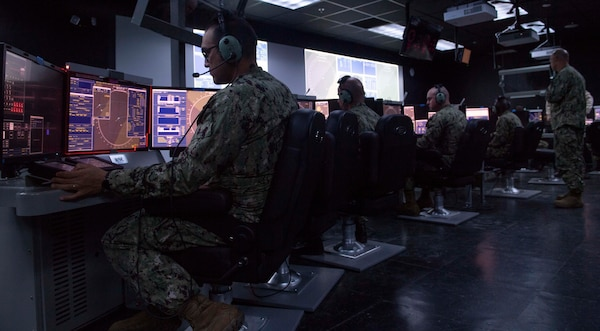 IMAGE: 190611-N-HV059-1063 NORFOLK (June 11, 2019) Sailors train on consoles in a simulated combat information center at Center for Surface Combat Systems' (CSCS) Combined Integrated Air and Missile Defense (IAMD) / Anti-Submarine Warfare (ASW) Trainer (CIAT), onboard Naval Base Norfolk.  CSCS' main mission is to develop and deliver surface ship combat systems training to the fleet and achieve surface warfare superiority. (U.S. Navy photo by Mass Communication Specialist 2nd Class Sonja Wickard/Released)