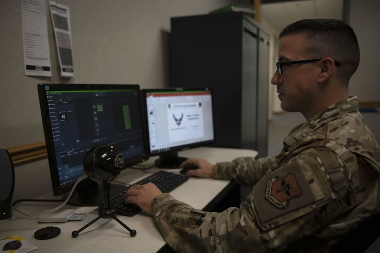U.S. Air Force Maj. Anthony Keith, Undergraduate ABM Course instructor, edits a lesson to upload online for students at Tyndall Air Force Base, Florida Aug. 6, 2019. The instructors spent hours recording and editing each lesson for students to have a unique learning format for the course. (U.S. Air Force photo by Airman 1st Class Heather Leveille)