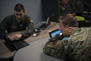 Undergraduate ABM Course students study material at Tyndall Air Force Base, Florida, Aug. 6, 2019. Students are given more freedom to study outside of the classroom by using tablets. (U.S. Air Force photo by Airman 1st Class Heather Leveille)