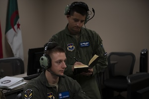 U.S. Air Force Capt. Ryan Oweida, right, Undergraduate ABM Course instructor, helps a student at Tyndall Air Force Base, Florida, Aug. 6, 2019. In the Combat Air Forces, students have the ability to plan, brief, execute and debrief all in the same system on the same day for 60 plus events, helping to reduce the time for training in the course. (U.S. Air Force photo by Airman 1st Class Heather Leveille)