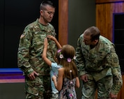 Molly and Kate Little of Pleasant Plains, Illinois, pin the rank of Chief Warrant Officer 4 on their father Ryan Little, the Senior Maintenance Officer, Joint Force Headquarters. Lt. Col. Kevin Little, Deputy Chief of Staff - Logistics, Illinois National Guard, officiated the ceremony.