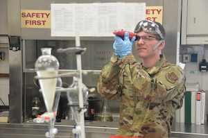 Senior Airman Connor McCann, a fuel specialist with the petroleum oil lubricants (POL) section of the 445th Logistics Readiness Squadron, demonstrates the proper procedures for testing fuel quality in a flash laboratory during his annual tour June 25, 2019 at Spangdahlem Air Base, Germany