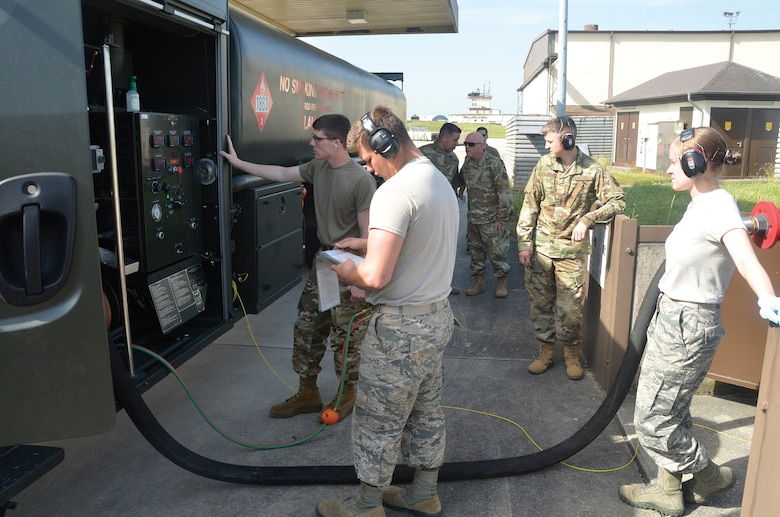 Fuel specialists with the 445th Logistics Readiness Squadron and the 52nd Logistics Readiness Squadron fill a fuel transport vehicle with fuel June 25, 2019, at Spangdahlem Air Base, Germany.