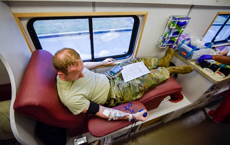 "An Airman participates in a blood drive conducted by the Arkansas Blood Institute at Little Rock Air Force Base, Ark., August 4, 2019. The Arkansas Blood Institute is a non-profit blood center whose volunteer donors provide every drop of blood needed by patients in 40 Arkansas hospitals. The number one reason donors say they give blood is because they ""want to help others."" (U.S. Air Force photo by Senior Airman Byrnes)"