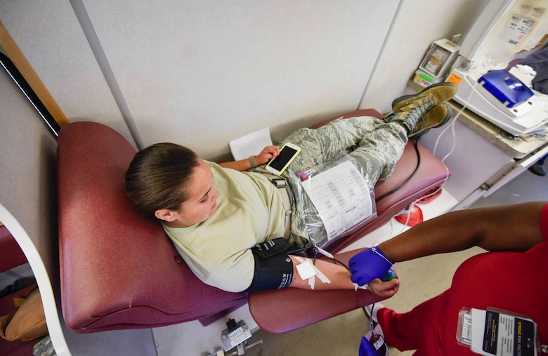 Team Little Rock Airmen donate blood and blood platelets during a blood drive held on August 4, 2019, at Little Rock Air Force Base, Ark. In order to extract platelets, specialists use apheresis machines to draw blood and return the unused portions of the donor. Platelets are tiny cells in the body that form clots and stop bleeding. They are essential to surviving traumatic injuries. Platelets must be used within five days and new donors are needed every day. (U.S. Air Force photo by Senior Airman Nathan Byrnes)
