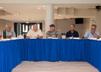 U.S. Air Force Col. Clinton Ross, 633rd Air Base Wing commander (center), sits with local Native American group representatives during a tribe consultation tour at Fort Eustis, Virginia, Aug. 7, 2019.