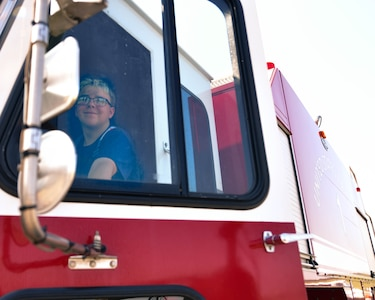 Tristan Jolley, Fire Explorer Academy cadet, opens a fire truck door during an exercise on Joint Base Andrews, Md., July 27, 2019. On the final day of the academy, Jolley and 10 other cadets demonstrated the skills they learned during the 6-day long program.