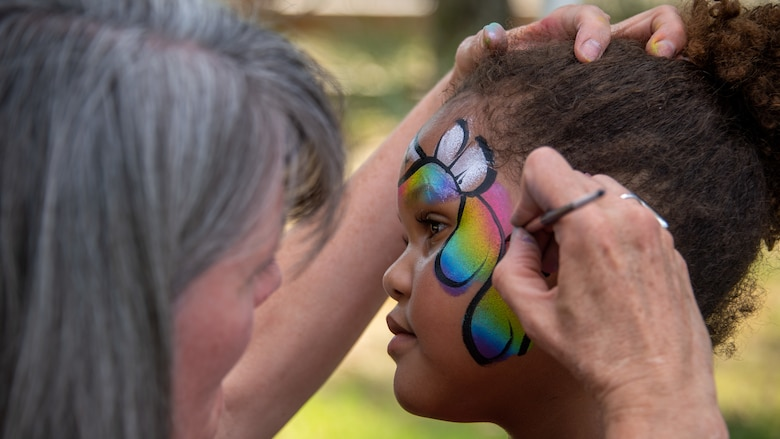 Delainie Rice gets her face painted during the annual Salute Picnic at Hill Air Force Base, Utah, Aug. 2, 2019. This was the 19th year the Top of Utah Military Affairs Committee  sponsored the event for Hill's military and family members. The first event was held December 2001 as a welcome home celebration for military deployed following 9/11. (U.S. Air Force photo by R. Nial Bradshaw)