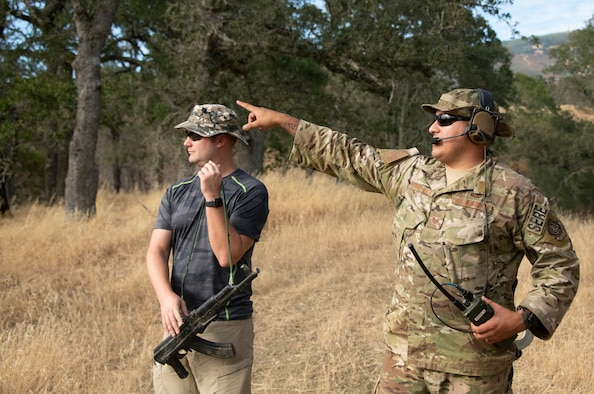 U.S. Air Force Tech. Sgt.Scott Siesel, 60th Operations Squadron wing tactics NCO in charge, and Tech. Sgt. Emanuel Espino-Mata, 60th OSS NCOIC of survival, evasion, resistance and escape operations, discuss logistics during a SERE training exercise that will last well into the evening Aug. 5, 2019, in a remote area near Travis Air Force Base, California. SERE instructors conduct the training to improve aircrew's skill sets and update them on new techniques, procedures and technologies. (U.S. Air Force photo by Heide Couch)