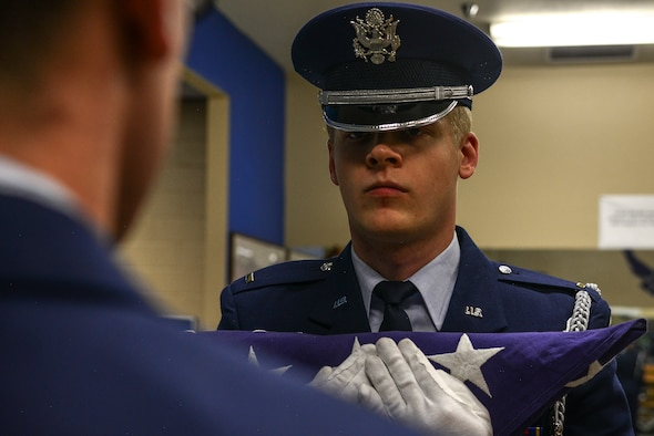 U.S. Air Force 2nd Lt. Andrew Vogel, Kirtland Air Force Base Honor Guard Delta Flight officer in charge, takes part in a practice of a seven member funeral ceremony.