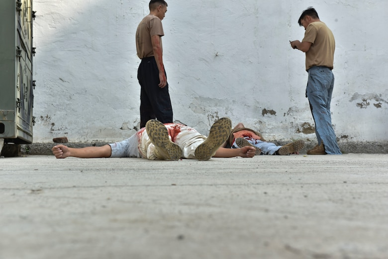 Two simulated casualties lie on the ground waiting for a mass casualty exercise to begin Aug. 1, 2019, during Pacific Angel 19-3 in Ulaanbaatar, Mongolia. PAC ANGEL is a joint and combined humanitarian assistance engagement, enhancing participating nations' humanitarian assistance and disaster relief capabilities while providing beneficial services to people in need throughout South and East Asia. (U.S. Air Force photo by Senior Airman Eric M. Fisher)